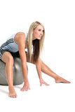Good looking blond working out. Jeanne Marie in gym outfit on ball Royalty Free Stock Photography