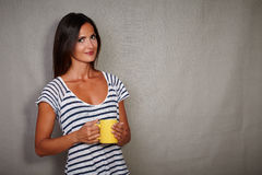 Good-looking brunette female holding coffee cup Royalty Free Stock Images