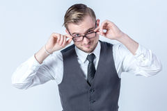 Good looking business with glasses man thinking about something. Good looking business man with suit with glasses man thinking about something Royalty Free Stock Photos