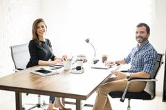 Latin business partners in an office Royalty Free Stock Photos