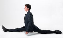 Good-looking businessman doing splits Stock Image