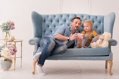 Good looking caring father playing with his daughter Royalty Free Stock Photo