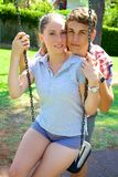 Good looking couple with blue eyes relax in park looking Stock Photo