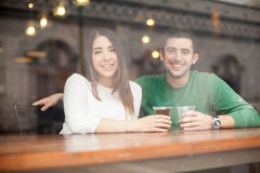 Good looking couple drinking beer at a bar Stock Photos