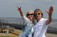 Good looking couple. Enjoying their holiday. They are at the viewpoint of brown coal open mining in Garzweiler, Germany stock photography