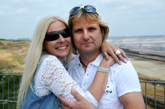 Good looking couple. Enjoying their  holiday. They are at the viewpoint of brown coal open mining in Garzweiler, Germany Royalty Free Stock Photos