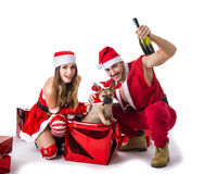 Good looking couple in Santa Claus hat with Christmas gift Stock Photography