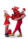 Good looking couple in Santa Claus hat with Christmas gift Royalty Free Stock Image