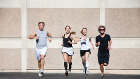 Good-looking couples out for a morning run. Stock Photos