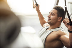 Good looking delighted man enjoying a workout Stock Photo