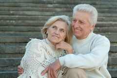Good-looking elderly couple at wall Stock Photo