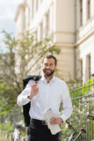 Good Looking Entrepreneur with Newspaper on Street Royalty Free Stock Photography