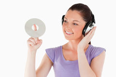 Good looking female with headphones Stock Photo