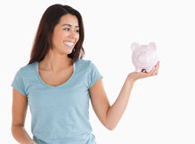 Good looking female holding a piggy bank Stock Photos