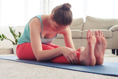 Good-looking female stretching in seated forward bend pose Royalty Free Stock Image