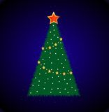 Good-looking festive fir-tree on a blue background Stock Photo