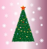 Good-looking festive fir-tree on a pink background Royalty Free Stock Image