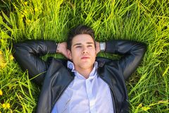 Good looking, fit male model relaxing lying on the Royalty Free Stock Photo
