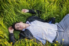 Good looking, fit male model relaxing lying on the Royalty Free Stock Image