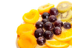 Good looking fruits on top of a yummy cake Royalty Free Stock Photo