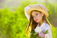 Good-looking gardener. Natural beauty and spa therapy. Spring woman. Springtime and vacation. Summer girl with long hair. Woman with fashion makeup. face and stock images