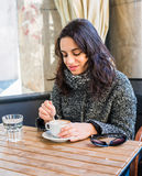 Good looking girl drinking cappuccino Stock Photography
