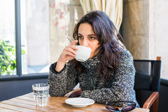Good looking girl drinking cappuccino and looking forward Stock Photo