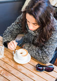 Good looking girl drinking cappuccino - top view Royalty Free Stock Photography