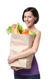 Good-looking girl with paper bag Stock Photos