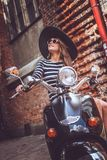 Good Looking Girl Posing On Stylish Scooter. Stock Photography