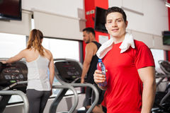 Good looking guy cooling off in a gym Royalty Free Stock Photography