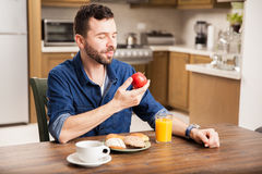 Good looking guy eating healthy Royalty Free Stock Photo