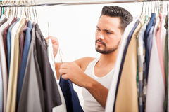 Good looking guy getting dressed Stock Photo