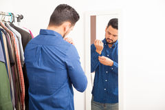 Good looking guy getting dressed at home Stock Images
