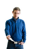 Handsome young man giving or handling sheet of paper Royalty Free Stock Photos