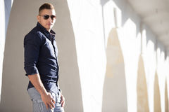 Good looking guy in sunglasses in the city Stock Images