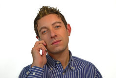 Good looking guy talking on cell phone. Attractive young man using his mobile phone, isolated on white Royalty Free Stock Photography