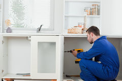 Good looking handyman fixing a door Stock Image