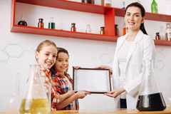Good looking happy girls holding the certificate Stock Images
