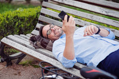 Good looking happy man using cellphone. Stock Image