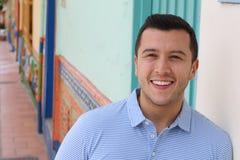 Good looking hispanic man headshot smiling outdoors.  stock photography