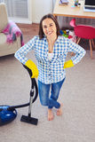 Good-looking housewife having finished cleaning of carpet Stock Photography