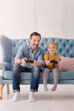 Good looking joyful father playing video games Royalty Free Stock Photos
