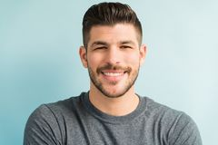 Free Good Looking Latin Man Against Turquoise Background Stock Photo - 161466720