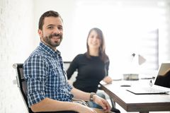 Attractive Hispanic man at his workplace Royalty Free Stock Photo
