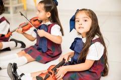 Pretty preschooler learning music stock photos