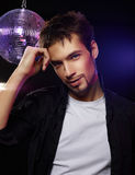 Good looking male on a disco. Portrait of a handsome male on in a club Stock Image