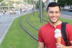 Good looking male happy with an ice cream.  Royalty Free Stock Photos