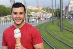 Good looking male happy with an ice cream.  Royalty Free Stock Image