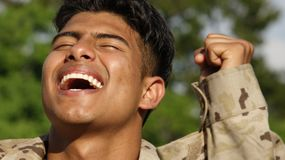 Good Looking Male Soldier Winner. A young hispanic male teen Royalty Free Stock Photography